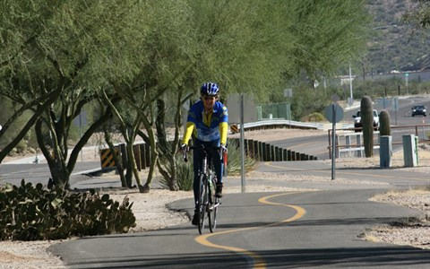 Bicyclist riding on a paved path