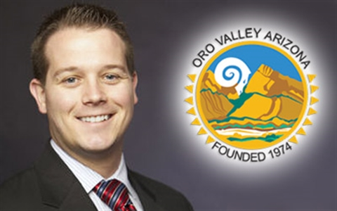Photo of Chris Cornelison with Town Seal